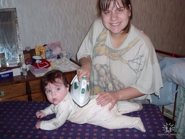 Mom Ironing on Baby